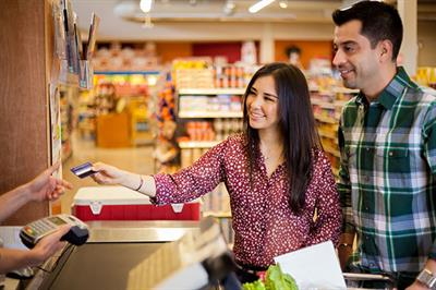 Couple paying for groceries with card