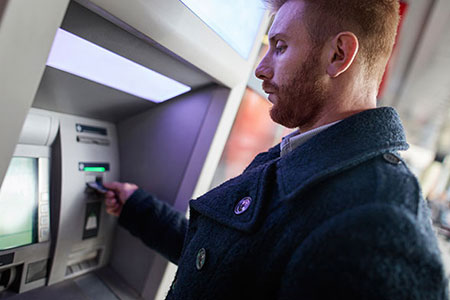 Customer at ATM Machine