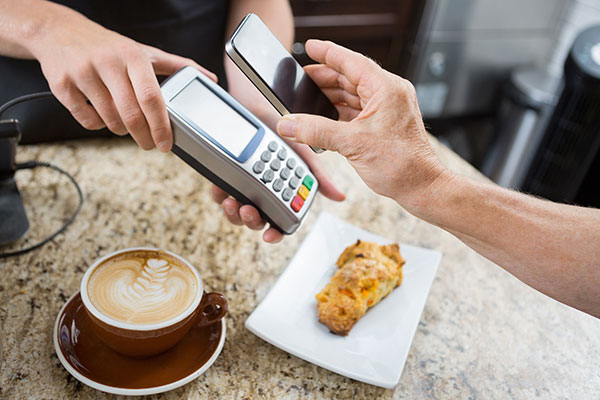 Paying-for-coffee-with-card-and-reader