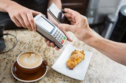 Paying for coffee with phone and reader